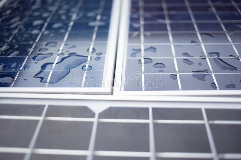 Close-up Solar panels solar cell. With water drop after the rain royalty free stock photography