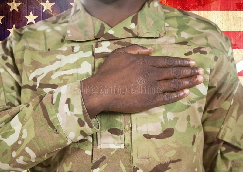 Close up of soldier with hand on heart in front of american flag royalty free illustration