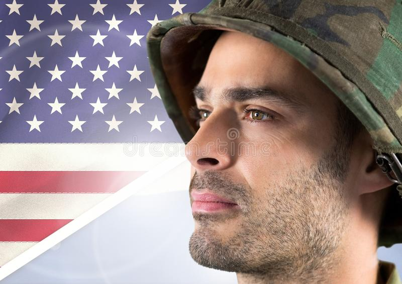 Close-up of a soldier looking horizon against american flag background stock image