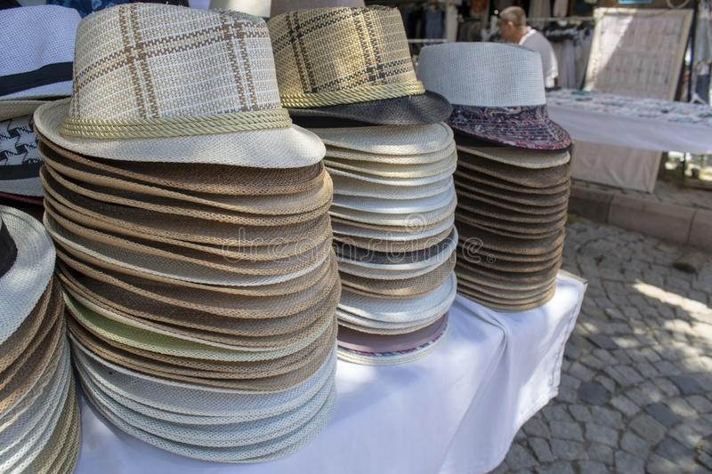 Close up of sombrero. It was filmed on the counter in front of the store. Fashion, fedora, market, straw, hat, summer, shop, retail, boater, trilby, sale stock images