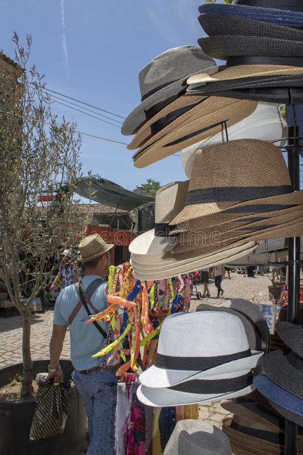Close up of sombrero. It was filmed on the counter in front of the store. Fashion, fedora, market, straw, hat, summer, shop, retail, boater, trilby, sale stock image