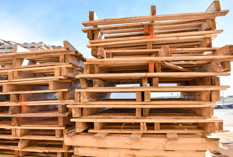 Piles of european pallets made in wood ready to be used transporting products or goods on them from a place to other by truck,. Close up of some piles of royalty free stock image