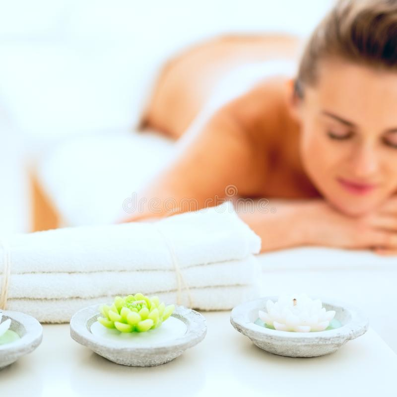 Closeup on spa elements and young woman in background stock photos