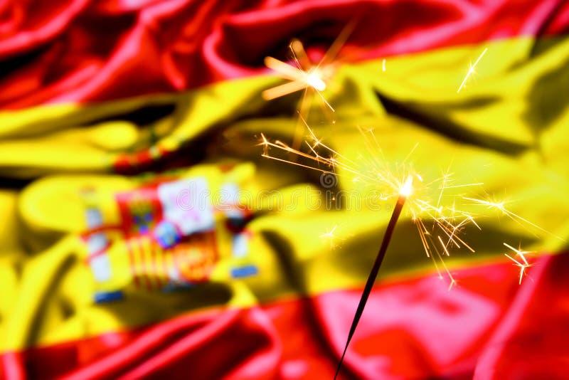 Close up of sparkler burning over Spain, Spanish flag. Holidays, celebration, party concept. Close up of sparkler burning over Spain, Spanish flag. Holidays stock image