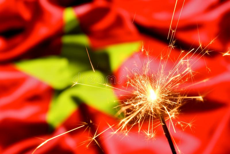 Close up of sparkler burning over Vietnam, Vietname flag. Holidays, celebration, party concept. Close up of sparkler burning over Vietnam, Vietname flag stock images
