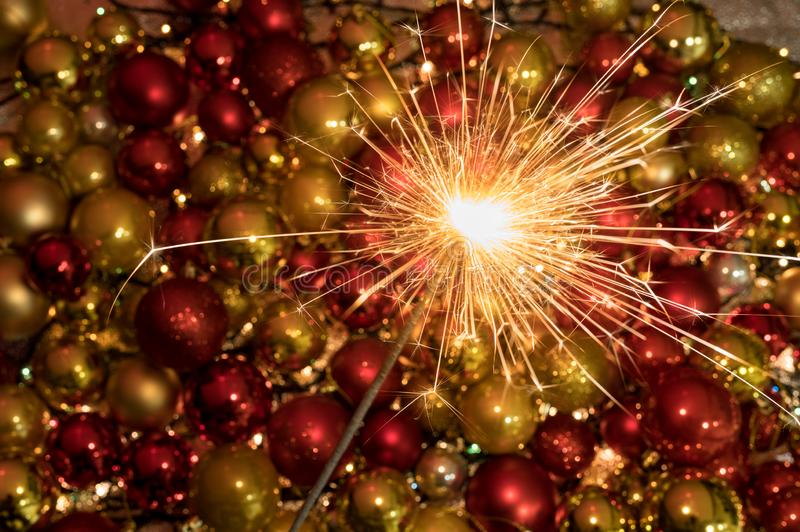 Close up sparkler firework light up in front of an amazing new year decoration stock photography
