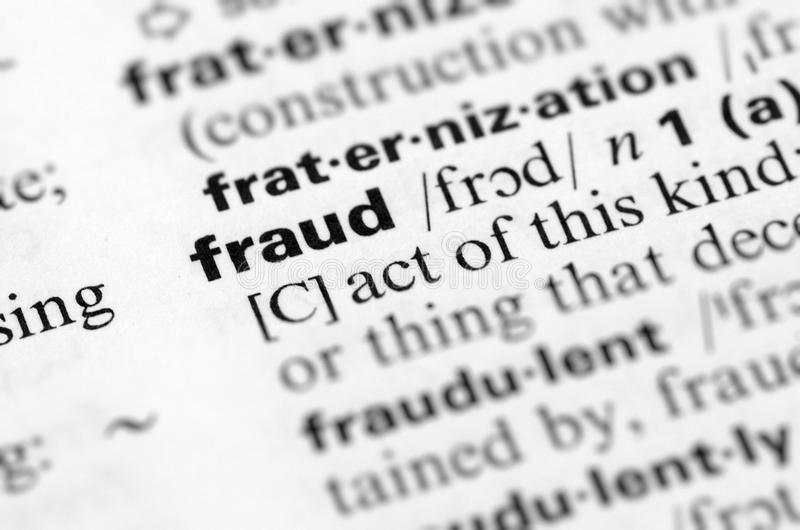 Close Up of Specific Word Fraud in a Dictionary royalty free stock images