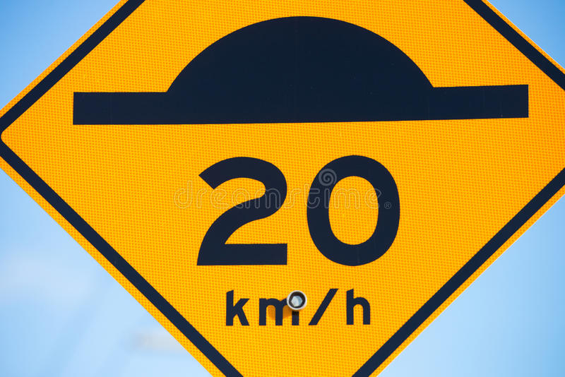 Close up Speed bump and slow down warning sign royalty free stock photos