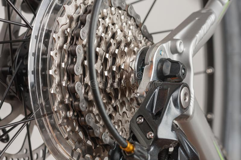Close up 9-speed cassette on rear wheel of bike, studio photo. stock photo