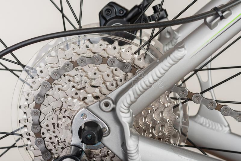 Close up 9-speed cassette on rear wheel of bike, studio photo. royalty free stock photo