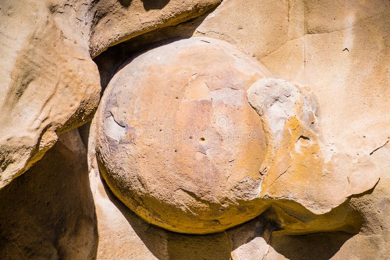 Close up of spherical concretion formed in a sandstone rock, revealed by the erosion happening throughout time, Contra Costa stock images