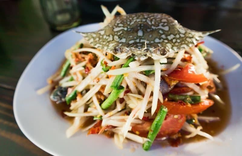 Close up of Spicy papaya salad with raw blue crab stock photos