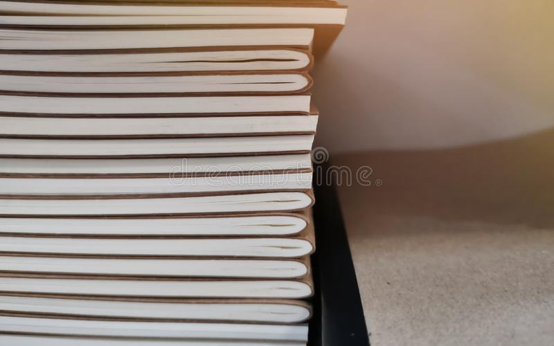 Close up spine books, brown and white background, Book stack on bookshelf in the library room.  royalty free stock photo