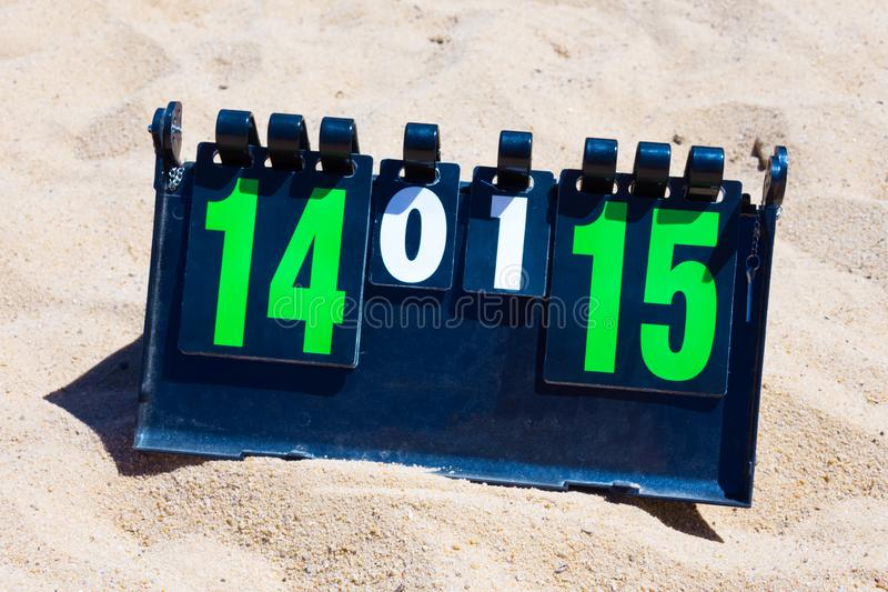 Close up of sport volleyball scoreboard on the summer sand. Score - 14-15 stock photos
