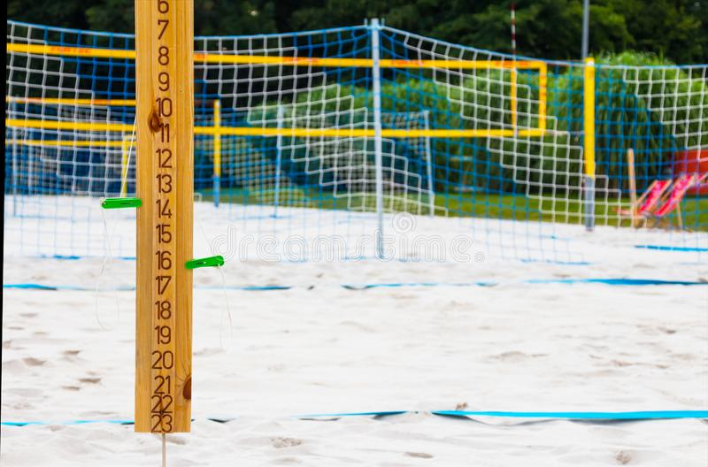 Close up of sport volleyball scoreboard on the summer sand. Wooden scoreboard. royalty free stock image