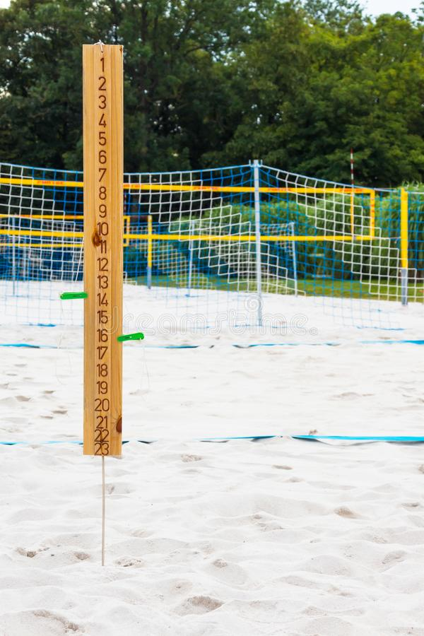 sport volleyball scoreboard on the summer sand. Wooden scoreboard. vertical stock images