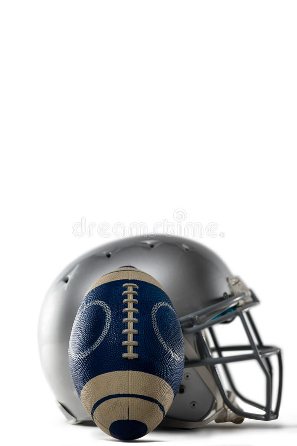 Close-up of sports helmet and football. Against white background stock images