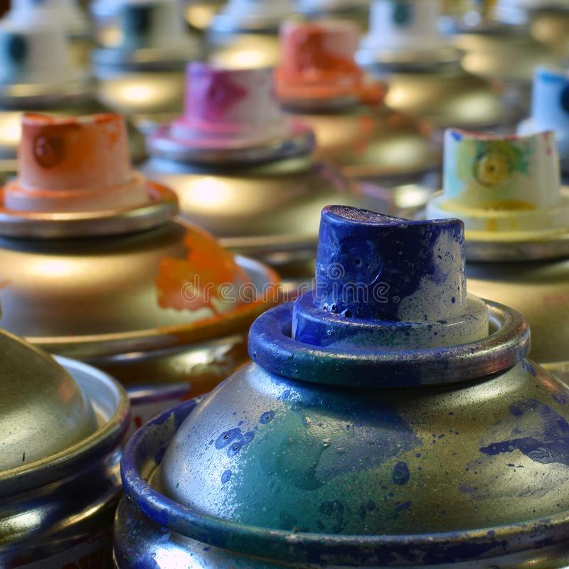 Close up of spray paint cans royalty free stock images