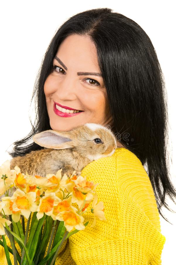 Close up of spring woman with bunny. Close up of spring woman with flowers and small bunny isolated on white background stock images
