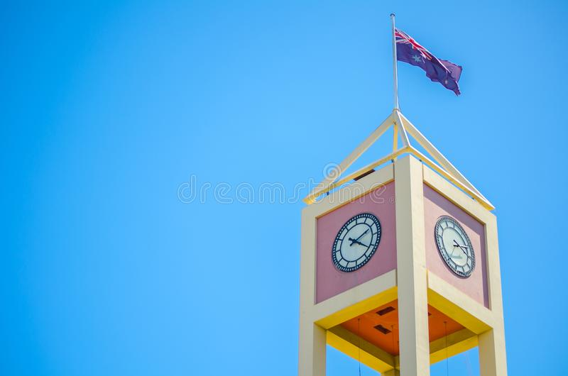 Close-up Square Clock tower at the Rocks, shopping mall with Australia Flag Sydney, Australia. stock photo