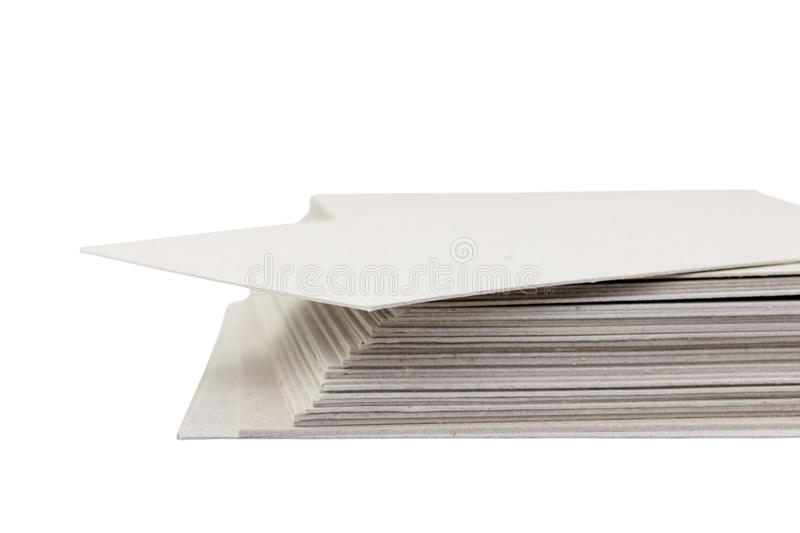 Close-up of stack cardboard on white background royalty free stock photo