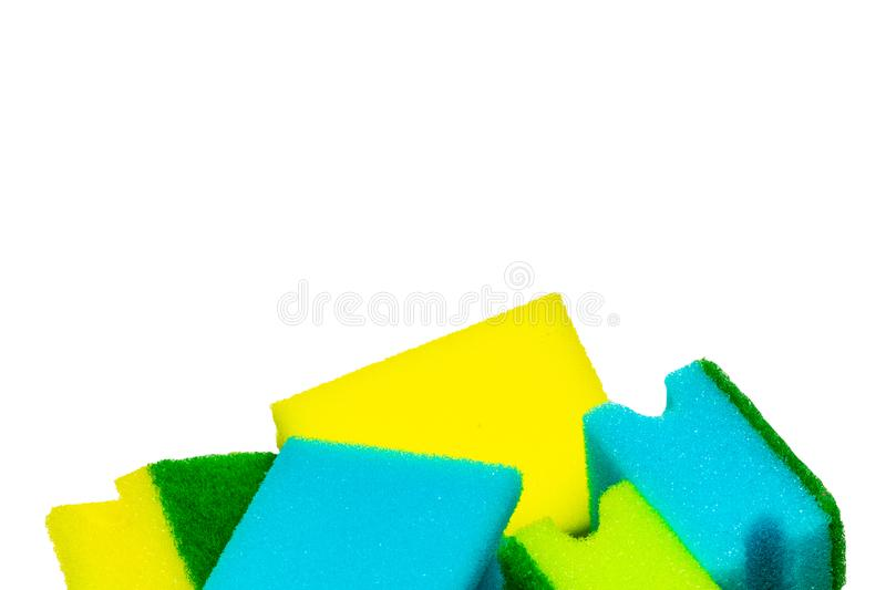 Close-up of a stack or heap of various colorful sponges or scouring pads isolated on a white background. Household chore concept. Macro. Top view royalty free stock photo
