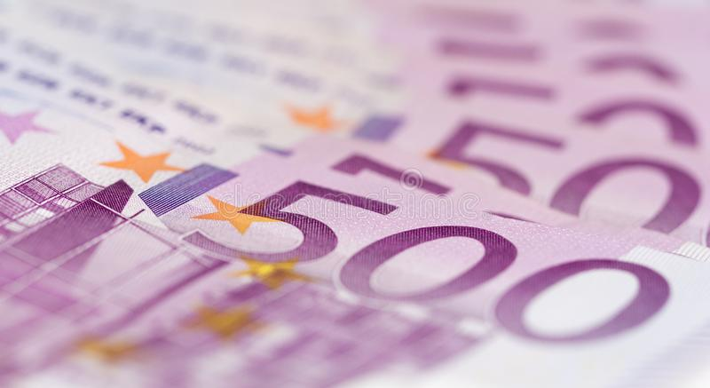 Close up from stack of money with 500 euro banknotes. Perfect for illustrating e.g. wealth, lottery prizes or banking crises. What is your dream stock photos