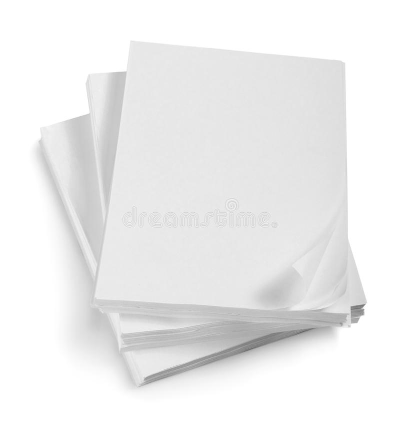 Close up of stack of papers with curl. On white background royalty free stock photography