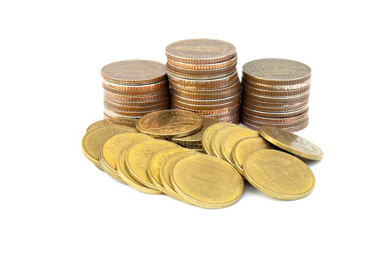 Stack or pile of old golden and silver coins isolated on white background. royalty free stock images