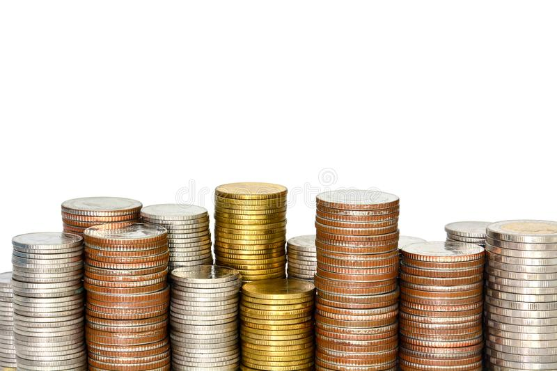 Close up stack of silver and gold coins isolated on white background, copy space, financial concept stock photography