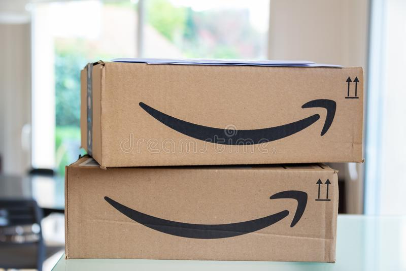 Closeup of a stack of two Amazon Prime parcel boxes just being delivered with mail stock photos