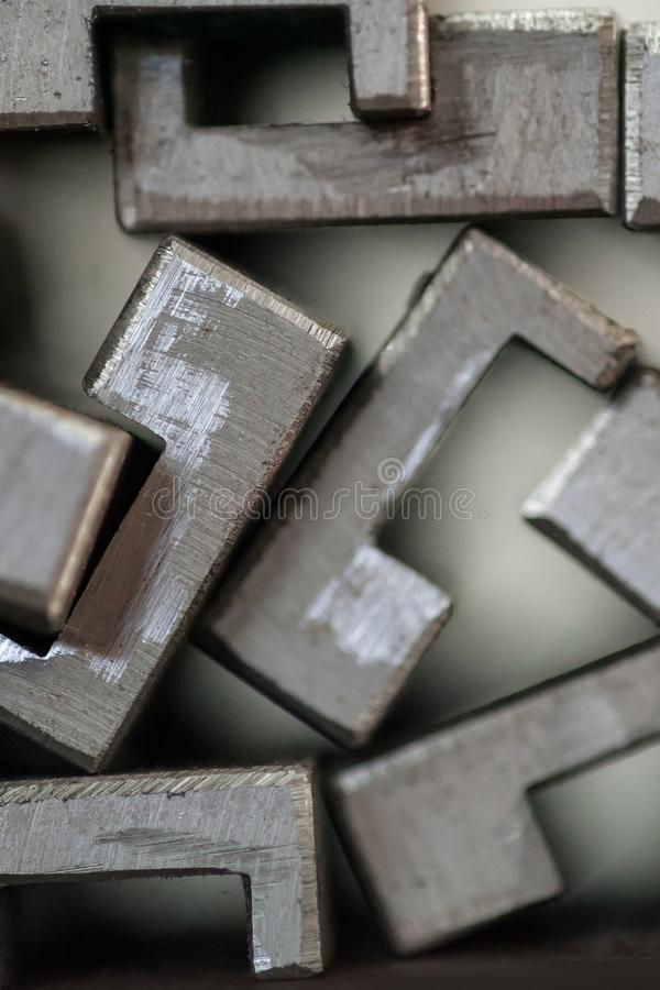 Close up of stacked metal plates stock image