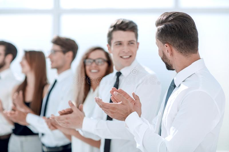 Close up.staff a standing ovation in the office. Business concept stock photography