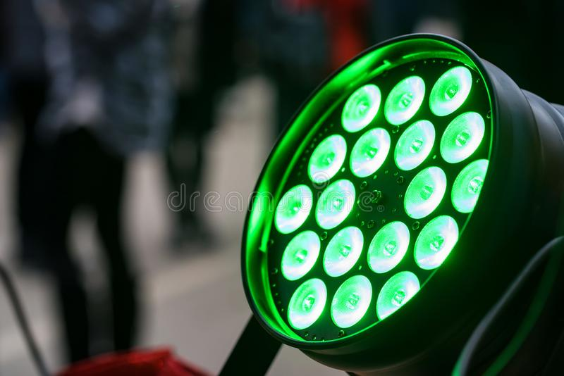 Stage green light source turned on. Close up of stage green color light source switched on royalty free stock photography