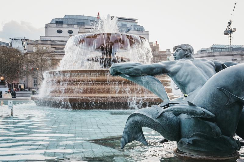 Close up of a statue and fountain on Trafalgar Square,London, UK royalty free stock photo