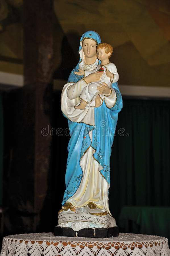 Close-up of statuette with image of Our Lady holding the boy Jesus. Close-up of statuette with image of Our Lady holding the boy Jesus in the Santuário das stock image