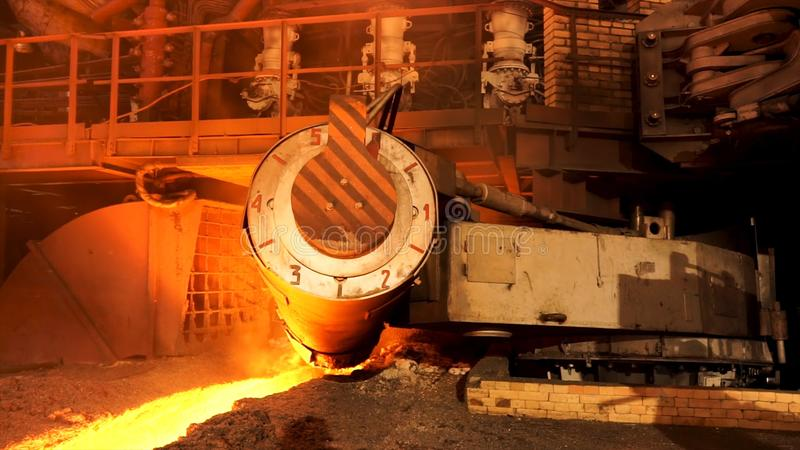 Close up for the steel furnace with temerature indicators at the metallurgical factory shop, heavy metallurgy concept. Working mechanism at the metal smelting royalty free stock image