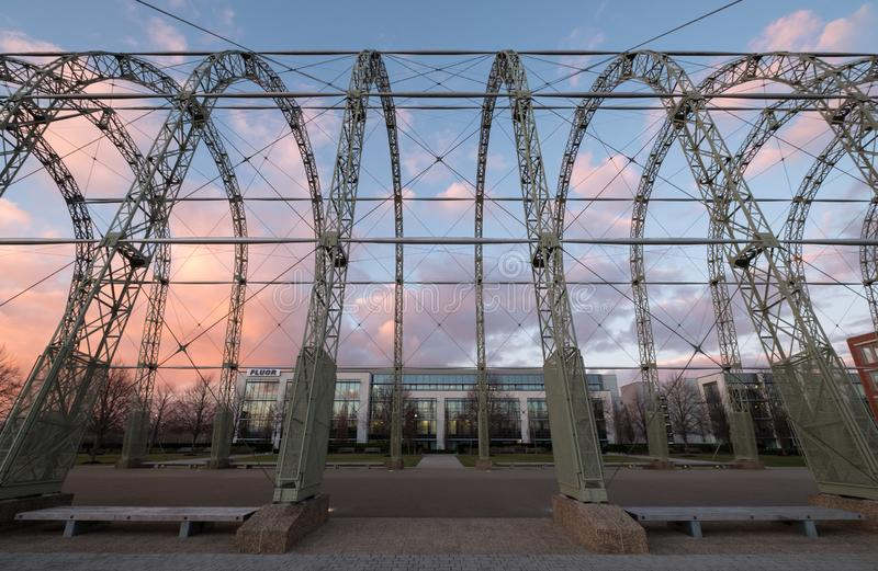 Close up of WW1 airship hangar on original Farnborough Airfield site, now Farnborough Business Park with Fluor offices behind. Close up of the steel structure of stock image
