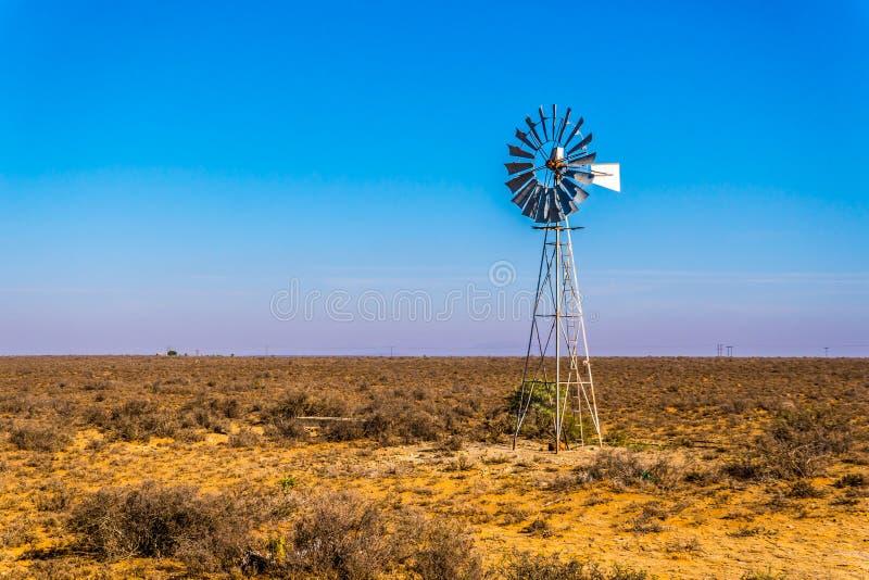 Steel Windpump in the semi desert Karoo region in South Africa. Close up of a Steel Windpump in the semi desert Karoo region in South Africa royalty free stock image