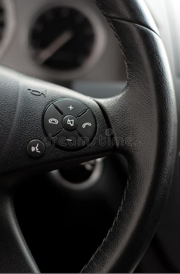 Close up of steering wheel of modern car royalty free stock photo