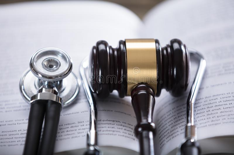 Close-up Of Stethoscope And Gavel. On Open Law Book royalty free stock images