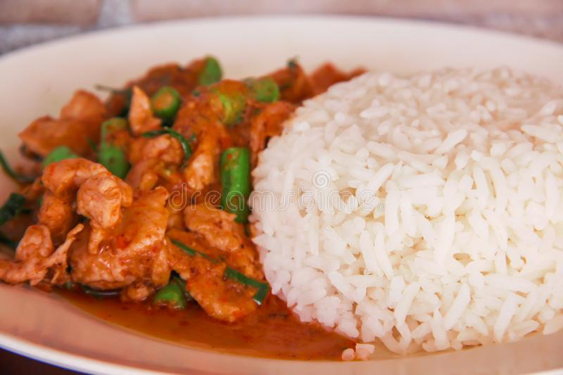 Close up stir fried pork with red curry paste and organic green bean , Thai food stock photos