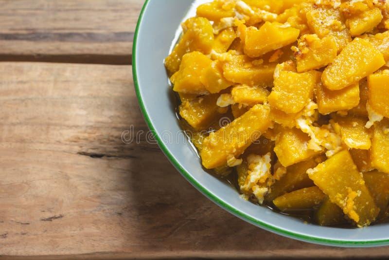 Close up Stir Fried Pumpkin with Egg. thai recipe. stock photo