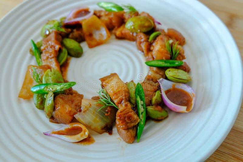 Close up Stir fried Sataw pork belly and shrimp paste on round plate. Close up Stir fried Sataw pork belly and shrimp paste stock photo