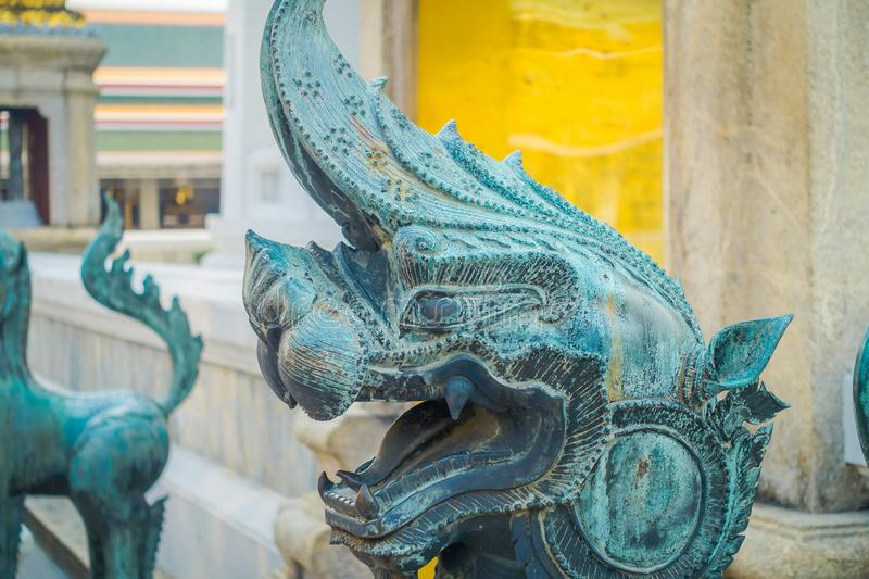 Close up of stone dragon statue located at the enter of Pranon Wat Pho, laying Buddha temple. In Bangkok Thialand royalty free stock photos