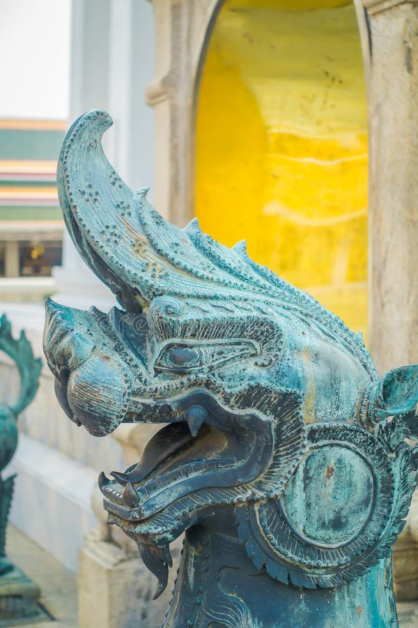 Close up of stone dragon statue located at the enter of Pranon Wat Pho, laying Buddha temple. In Bangkok Thialand royalty free stock image