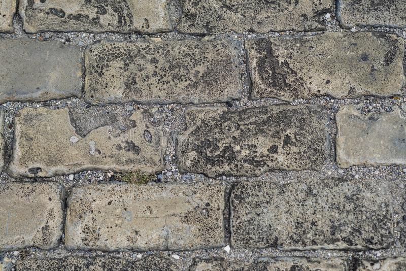 Close up stone pavement view from the top. Top view of stone pavement, texture. Granite cobblestoned pavement background royalty free stock images