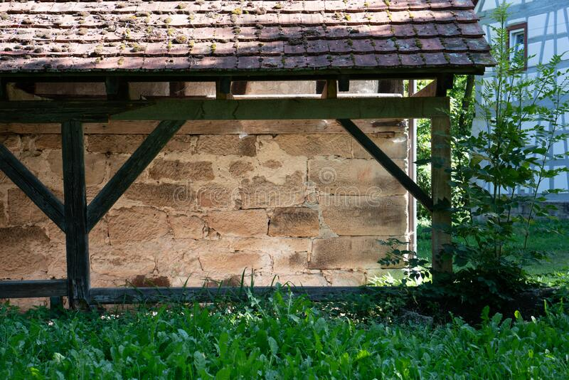 Close up of a stone shelter with timber frame in green nature. In the countryside royalty free stock image