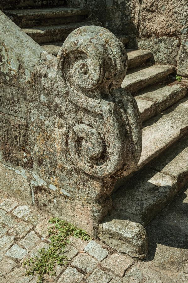 Close-up of stone staircase baluster with carved decoration. On an old gothic staircase, in a sunny day at Sortelha. One of the most astonishing and well royalty free stock image