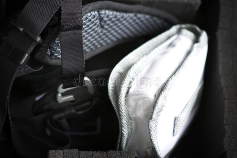 Close up of straps, buckles and camera bag. Detailed view of padded camera case with straps and buckles and padding in black case royalty free stock image